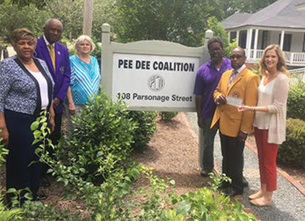 Omega Psi Phi Fraternity donates to Pee Dee Coalition