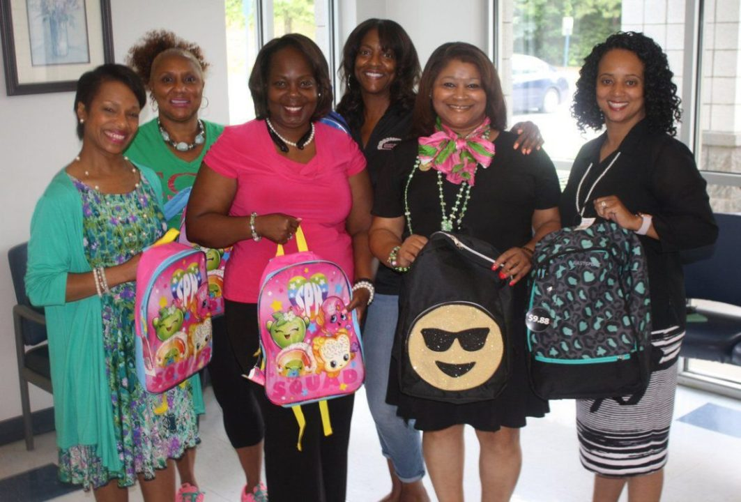AKA gives out 500 book bags to students
